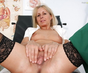 Fuckable mature nurse in stockings stripping and showcasing her cunt