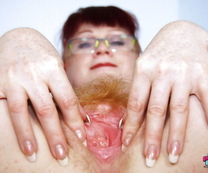 Filthy redhead mature nurse in glasses toying her hairy muff