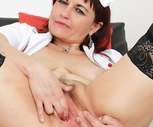 Turn over 50 nurse Remy spreading stocking clad fingertips for finger fucking for shrub