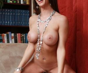 Busty brunette Rachel RoXXX struggles to undress before masturbating