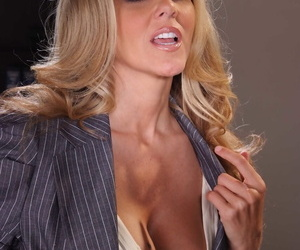 Blonde businesswoman Julia Ann strips naked on top of her office desk