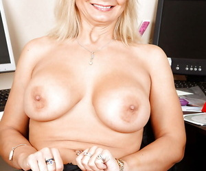 Mature lady to glasses effectuation to will not hear of round jugs coupled with huff and puff to rub-down the office