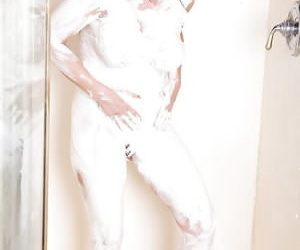 Naughty mature gloominess performs a foamy unassisted scene in the shower