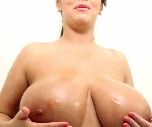 Leanne plays with the shower cap over her big boobs and down the pussy