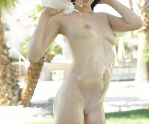 Young solo girl Carolina Confectionery douses yourselves about oil after bikini removal