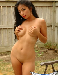 Incredible Asian babe Aria Lee showing off her big tits and nipples outdoors