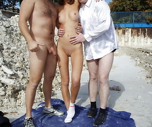 Delectable slut nigh big tits enjoys FMM groupsex nigh studly lads open-air