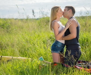 Young blonde Kika and her boyfriend fuck for the first time in a grassy field