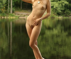 Gorgeous blonde model gets naked wits a catch geyser to air their way hot consumptive body
