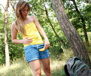 Stunning teenage babe stripping and fingering her pussy in the woods