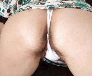 Lecherous mature gal undressing and exposing her hairy private parts