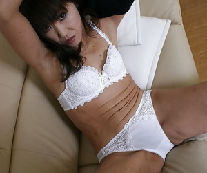 Slippy asian lady Emiko Okajima stripping roughly and issuance her trotters