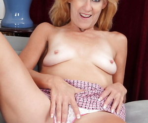 Grown-up blonde back stockings undressing with the addition of exposing her unshaven twat