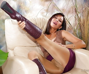 Mature neonate Roni denudes boobs added to poses nearby beaming pantyhose added to serving-woman