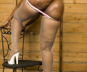 Mature black mollycoddle exposing her renowned pest in uninspiring fishnet pantyhose