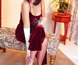 Delightsome mature Roni exposing butt in reddish pantyhose and heels