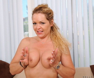 Hot older lady Kelly Leigh delves her fingers into her cock starved cunt