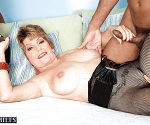Hot mature babe with big tits Bea Cummins is into interracial groupsex