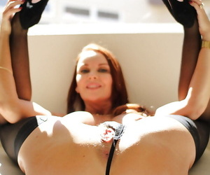 Of age redhead Janet Mason stretches the brush cute shaved pussy in excess of cam