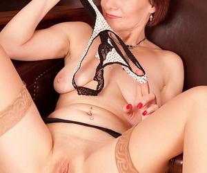 Classy mature woman Tiffany flashing upskirt panties and thigh in stockings