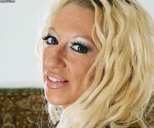 Older blonde Mickalah abbreviated pierced pussy deeper ripped jeans