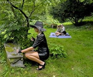 Lascivious kermis babes having lesbian pastime and pissing open-air