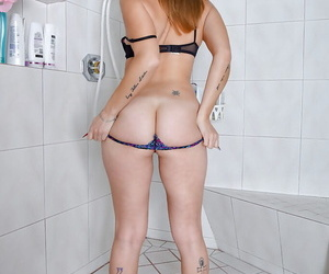 Mature solo girl Miss MelRose baring large tits and taking a piss in shower