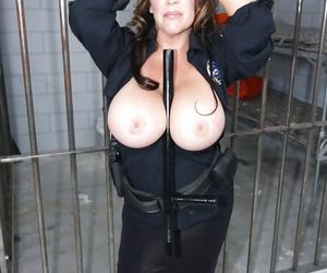 Busty mature babe Kandi Kox strips off uniform to tease her tits