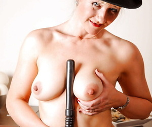 Mature hottie in police uniform exposing sexy melons and heated snatch
