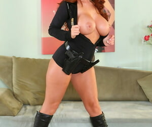 Voluptuous redhead babe Sophie Dee stripping off her police uniform