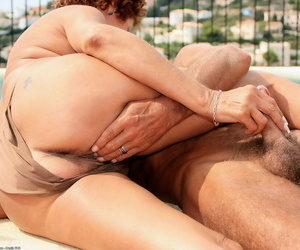 Mature lady Eve surprises her husband with a blowjob beside swimming pool