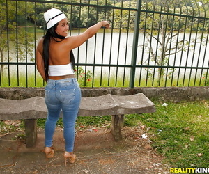 Brazilian MILF Alessandra Marques strutting outdoors in denim jeans