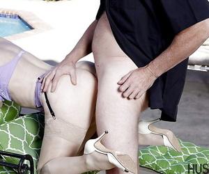 Older pornstar Nina Hartley having her vagina ate out of doors beside pool
