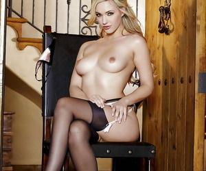 Sweet blonde in stockings Sophia Paladin showcasing her pink pussy