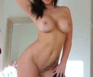 Dark haired beauty Jayden Jaymes slips off her black dress for nude poses