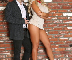 Latin bombshell Bridgette B displays her phenomenal breasts and juicy ass