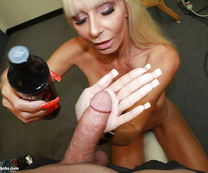 Experienced mature blonde gives a proper handjob on a big boner