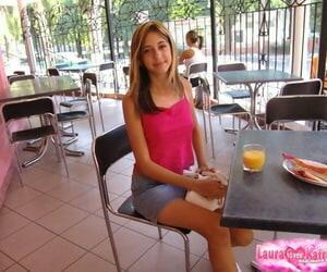 Elfin teen comprehensive poses non bare-ass in a denim skirt handy a hooch bar