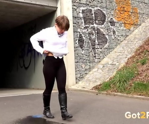 Short haired Shila in tall boots shows her shaved twat while peeing in public