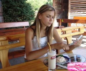 Young blonde bush-leaguer flashes naked upskirt dimension enjoying milkshake outdoors