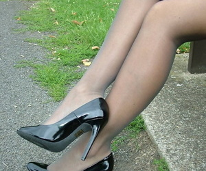 Clothed comme �a wide pink skirt showcases her nylon clad wings wide far-out arrogant heels