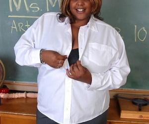 Mature ebony bus SSBBW Winxx is undressing in the classroom