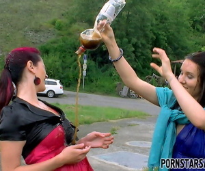 Stunning fetish babes having some wet fun in public place