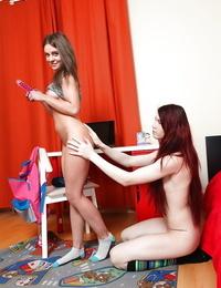 European teenagers Linda Y and Loveina go girl on girl in bedroom