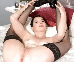 Short haired abandon 40 lady Kali Karinena spreading shaved cunt in swaggering heels