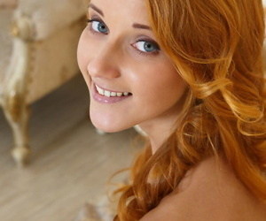 Redhead glamour babe Roberta Berti spreading shaved teen vagina