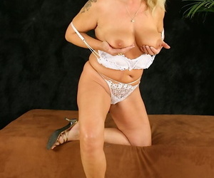 Salacious tow-haired of age lassie thither lingerie revealing the brush jugs and pussy