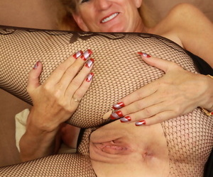 Older woman Raylynn rips open mesh pantyhose to play with her vagina