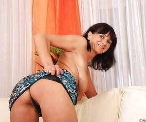 Mature brunette Chelsea is showing her saggy tits and big ass