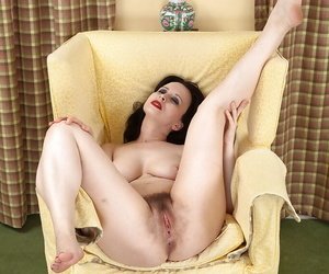 Doyen dark haired lady Nikita airing out her flimsy shrub beside panty removal